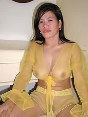 Asian amateur wife in sexy yellow lingerie fingers her trimmed pussy