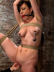 Bound with her leg up and wet...