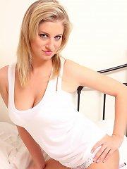 Blonde cutie shaking her boobies