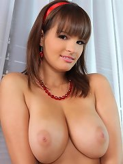Busty babe Rita toys with herself