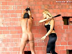 Strict mistress Irina brings her slave to the...