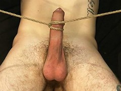 Stud with a 10 inch cock gets tied up for the first time.