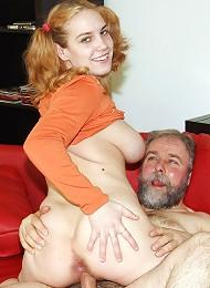 Teen redhead riding a senior cock