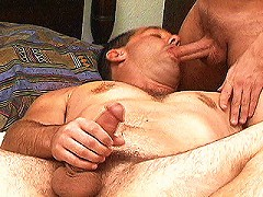 Hairy hunk stuffing a huge cock in his hungry mouth