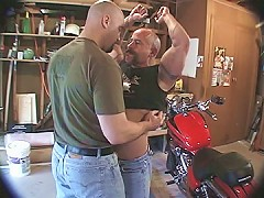 Muscle bears suck cock in the shop