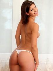Demi - Lovely brunette strips and spreads