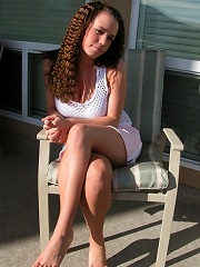 Bruntte teen with crimped hair and big tits