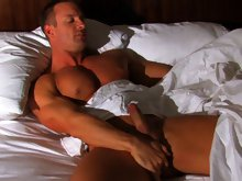 In his second MuscleHunks.com appearance, hunky muscle dude T.J. Cummings wakes up in the middle of the night in his hotel suite, finding himself alon