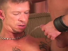 Hunkish twink, Drew Peters, and leather daddy, Chris Neal pair up in this hardcore scene. The two dirty studs piss on each other, Drew takes dildo aft