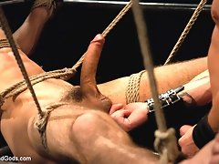 Brenn Wyson ties up two studs in leather hoods and fucks them hard