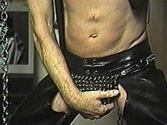 Leather clad old guy masturbates