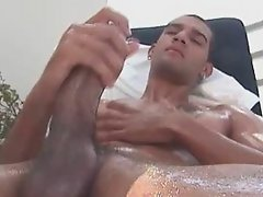 This sexy lad imaginates dirty thing while jerking his monster latino dick