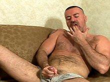 Mature gay bear stroking his cock