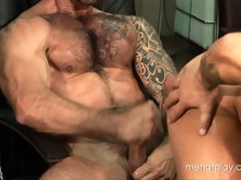 Two hairy muscle hunks take off suits and fuck on the office table