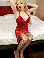 Japanese Newhalf Mana is so seductive in red, with her tight fishnet stockings and heels. The famous AV actress from Osaka has made a name for herself