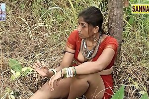 Hot Indian Babe Wears Sexy Red Clothes While Relaxing In A Lake