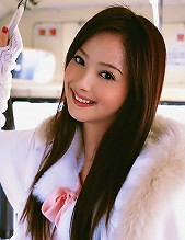 Beautiful asian princess looks gorgeous in her pink sweater