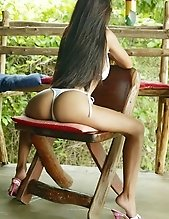 Asian hottie in sunglasses slowly undresses for you