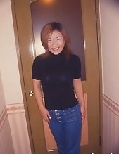 Busty Japanese opens her wet pussy