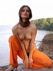 Zemani.com Lenusya - Slim beautiful girl with long hair takes her clothes off and poses nude on the beach.