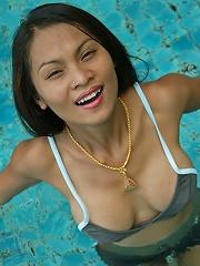 Thai adult model Tailynn Posing Sensually by the Pool