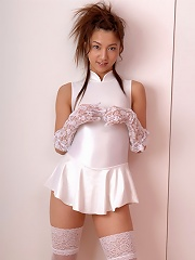 In her white stockings this beautiful gravure idol is delectable