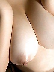 Hot Japanese babe enjoys masturbating her pussy and fondling her big tits