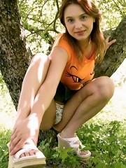brunette teen wandering in the woods