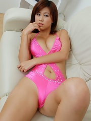 Gorgeous asian babe shows off her long legs in a sexy pink bikini