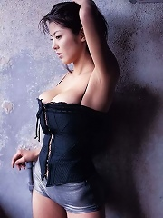 Plump boobs spilling out of a tight corset worn by asian model