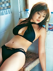 Gorgeous asian babe shows off her stacked body and plump boobs