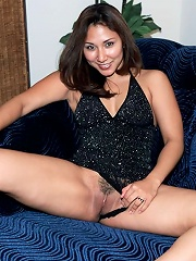 Sexy asian babe with big breasts spreading her shaved pussy
