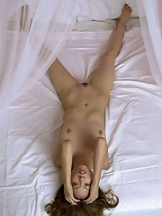 Long haired asian beauty spreads her wet pussy just for you